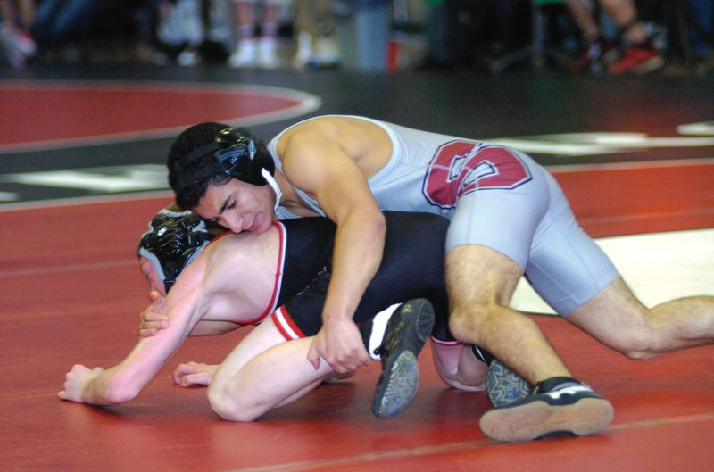 by: SANDY POST: PARKER LEE - Sandys Edin Zepeda works to turn his opponent during last weekends Carey Larson Memorial wrestling tournament.