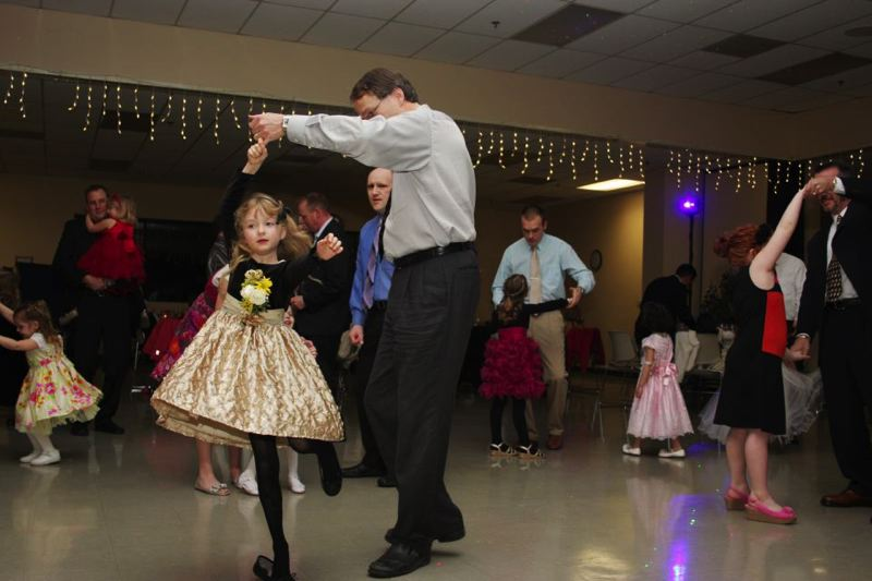 by: PHOTO COURTESY: NORTH CLACKAMAS PARKS & RECREATION DISTRICT - Dads and their daughters get out on the dance floor during last year's event at the Milwaukie Center.