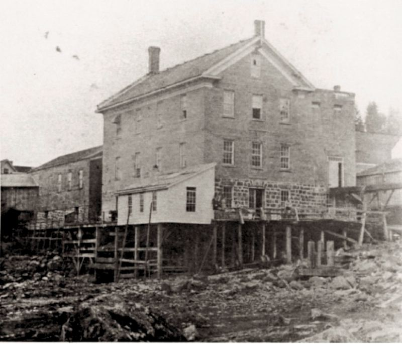 by: OREGON HISTORICAL SOCIETY - Oregon City's Brick Mill, shown during the 1870s, is located in the future area of the Blue Heron paper mill.