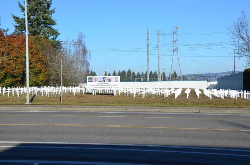 by: SUBMITTED PHOTO COURTESY OF STEVE HOLTHOUSE - It took members of St. Francis Catholic Church about two hours to install 530 crosses along Tualatin-Sherwood Road Saturday.