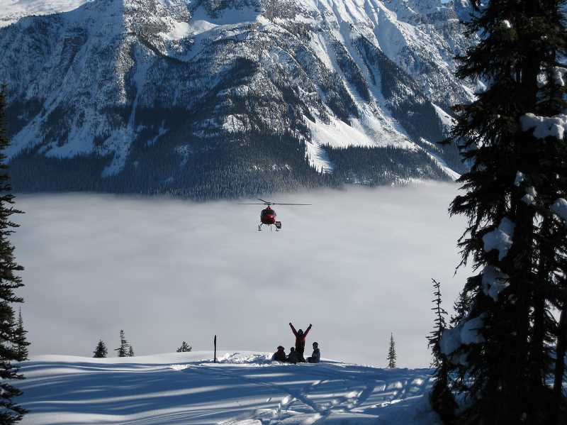 by: SUBMITTED PHOTO - A helicopter soars through the winter wonderland at the Silvertip Club in Canada. Club owner John Baker is offering an all-around spectacular experience.