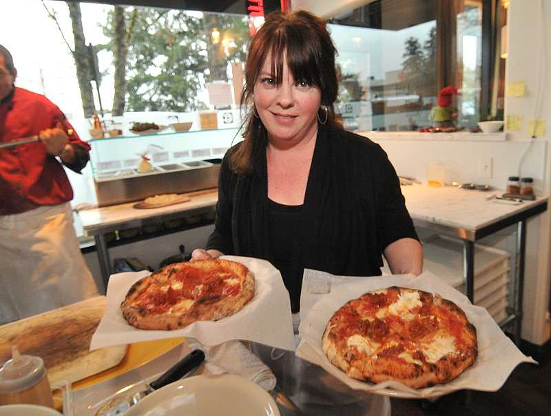 by: REVIEW, TIDINGS PHOTO: VERN UYETAKE - Lisa Shaw-Ryan handles rush hour at Chuckie Pies. The new pizza parlor on Fifth Street is a paradise for Neapolitan pizzer lovers.