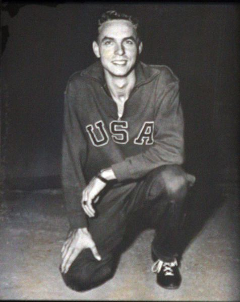 by: OUTLOOK PHOTO: JIM CLARK - Clem Eischen set up his first SportsCare Physical Therapy clinic in 1963 in Troutdale. A photo on the wall in the office shows the 68-year-old founder when he was part of the U.S. Olympic Team as a runner, in the 1948 London games.