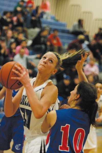 by: PHIL HAWKINS - Woodburn senior Celine Gregoire scored a team-high 17 points to help the Bulldogs erase a five-point deficit heading into the fourth quarter against the Churchill Lancers Friday night. Woodburn outscored Churchill by nine to pull away with the teams fourth victory of the season.