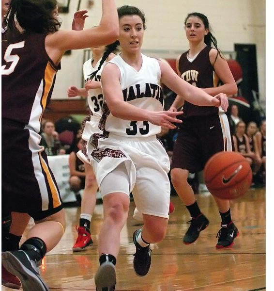 by: DAN BROOD - GOOD FOR THREE -- Tualatin High School senior Tessa Bullis sank seven three-pointers for the Timberwolves in their 59-36 win over The Dalles Wahtonka on Friday.