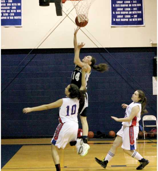 by: CORY MIMMS - Brittnea Corless goes for the layup.