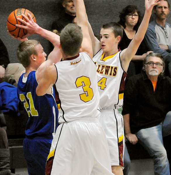 by: SETH GORDON - Turning the screws -- Joseph (No. 3) and Ryan Brooks hound a Portland Waldorf player as part of C.S. Lewis Academy's full-court press on Friday. The Watchmen used their pressure to great effect, racing to a 40-15 lead by halftime en route to a 62-33 home victory.