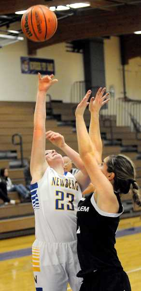 by: SETH GORDON - Up and over -- Hannah Green puts up a shot during Newberg's 56-47 home loss to West Salem Friday night. The senior guard scored six points, but the Tigers offense stalled in the third quarter, allowing the Titans to seize control of the game.
