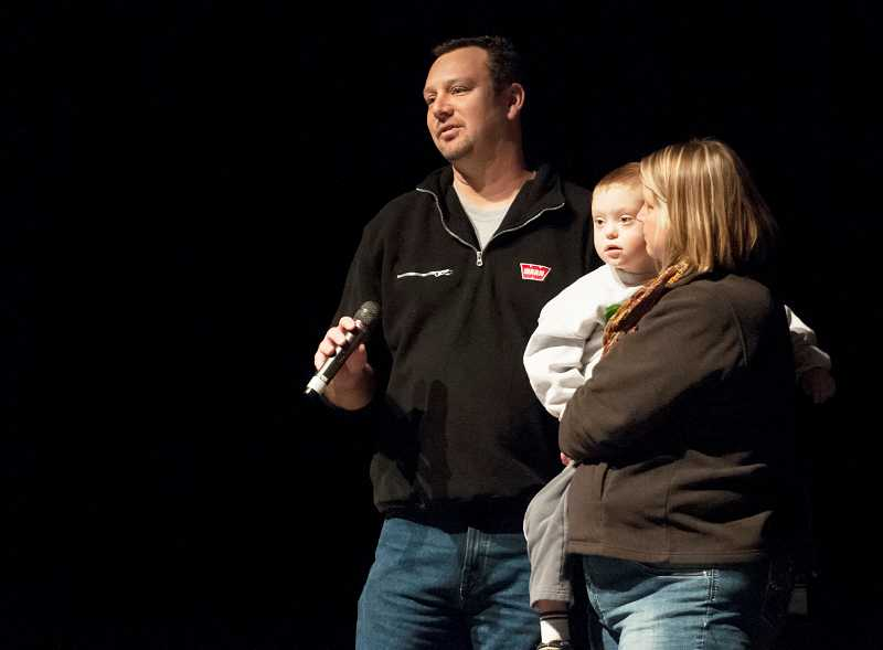 by: PAMPLIN MEDIA GROUP: JOSH KULLA - Jim Hartley, with son, Benny, and wife, Deborah, addresses students during an assembly Nov. 15.