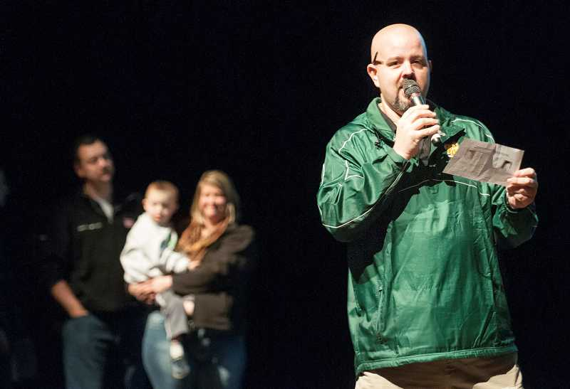 by: PAMPLIN MEDIA GROUP: JOSH KULLA - West Linn High School teacher Butch Self explains to students how they can log their community service hours to benefit their sparrow, Benny.