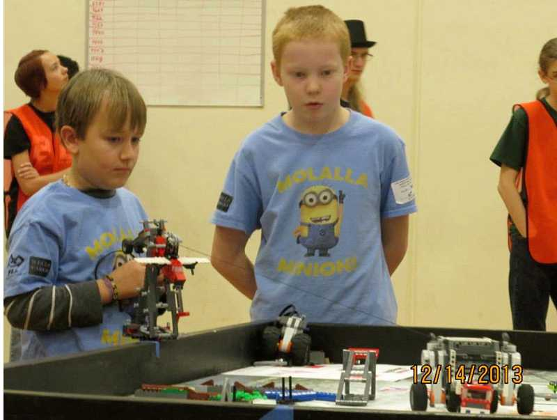 by: SUBMITTED - Minions AJ Deardorff and Ethan Lazar compete with the team robot.