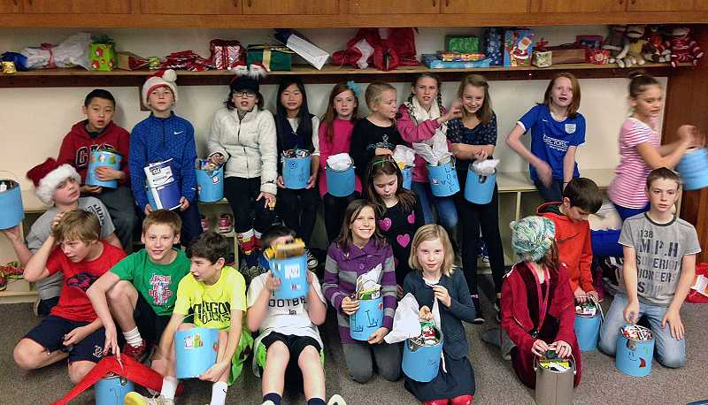 by: SUBMITTED PHOTO - Forest Hills teacher Tammi Leachs fifth-graders pose with their gift buckets.