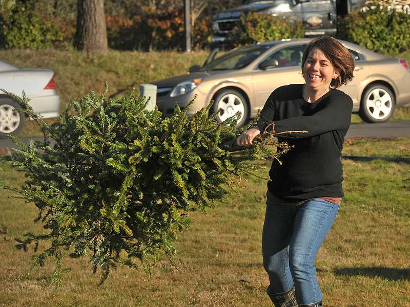 by: REVIEW PHOTO: VERN UYETAKE - Lisa Procter demonstrates her form as she attempts a tree toss.