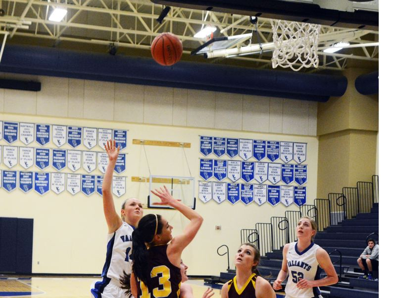 by: TIMES PHOTO: MATT SINGLEDECKER - Valley Catholic shooting guard Lindsie LaBonte puts up a tear drop for two against Damascus Christian. LaBonte led the Valiants with 16 points.