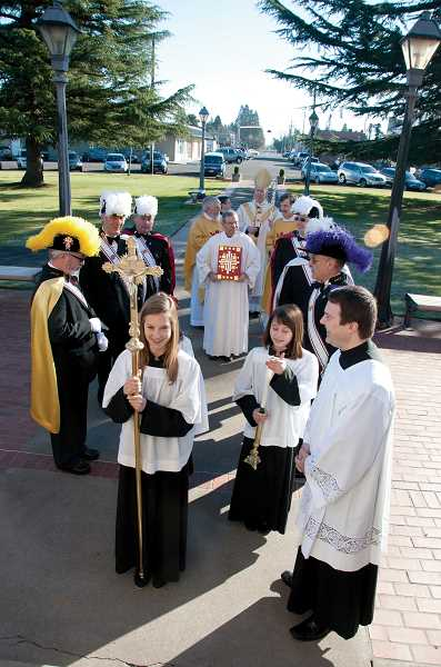 by: LINDSAY KEEFER / WOODBURN INDEPENDENT - Proceed to the celebration - A procession of church officials enters St. Paul Catholic Church on Jan. 5 to celebrate the 175th anniversary of the first Mass held in Oregon.