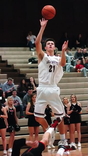 by: DAN BROOD - STEVEN SURESHOT -- Tualatin junior Steven Shockloss puts up a shot in the Wolves' game with Clackamas.