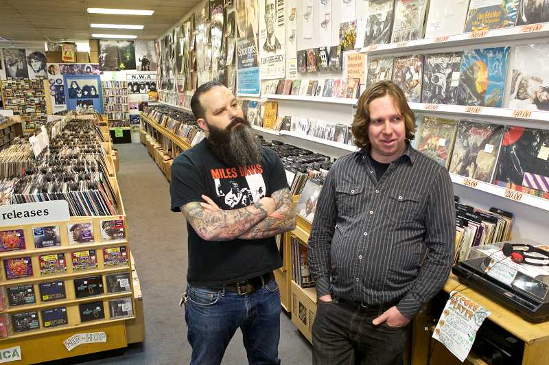 by: TIMES PHOTO: JAIME VALDEZ - Everyday Music co-managers Rian Zenner and Patrick Bocarde discuss the record store business in mid-December at the long-running store in Cedar Hills.