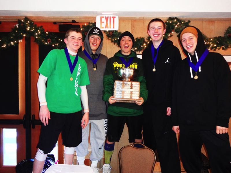 The West Linn boys ski team holds the trophy from last week's Cato Memorial Race. The Lions won the event for the third year in a row. The West Linn girls took third place at the competition.
