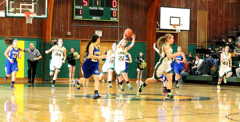 by: CORY MIMMS - Viking Kailee White in possession of the ball, as the Vikings break down court in the first quarter.