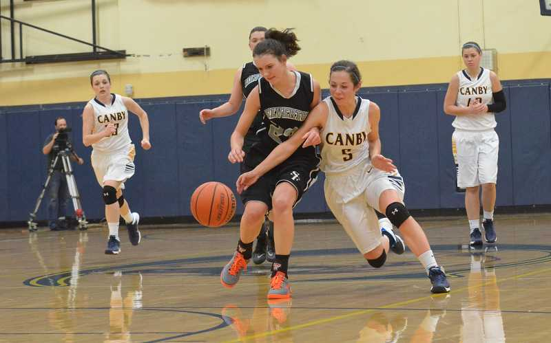 by: JEFF GOODMAN / PAMPLIN MEDIA GROUP - Morgan Meisenheimer (5) chases after a loose ball Jan. 3 during the Canby girls basketball team's win over Silverton.