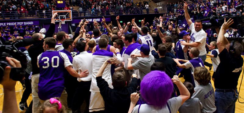 by: COURTESY OF STEVE GIBBONS - Hundreds of Portland Pilots fans rush the court after their team knocks off nationally ranked Gonzaga on Thursday night at Chiles Center.