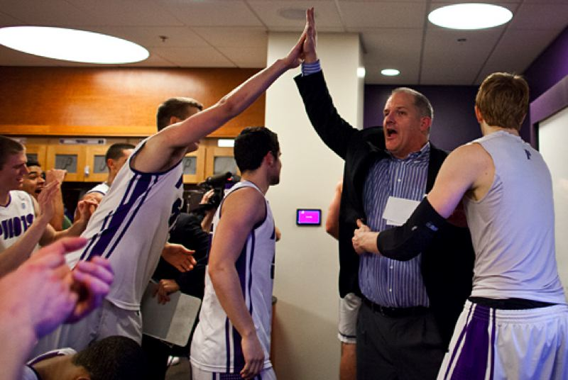 by: COURTESY OF STEVE GIBBONS - University of Portland coach Eric Reveno gives out high fives in the locker room after the Pilots' upset victory over Gonzaga at Chiles Center.