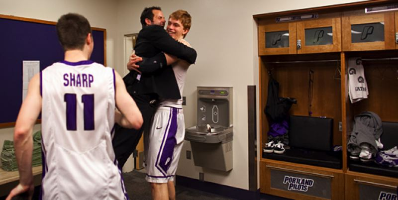 by: COURTESY OF STEVE GIBBONS - UP strength coach Bradford Scott jumps into the arms of Riley Barker in the locker room after the game.
