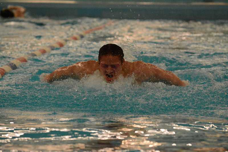 by: FILE / PAMPLIN MEDIA GROUP - Noah Norris and the Wilsonville boys swimming team topped Putnam in a league dual Jan. 9 to remain undefeated in the NWOC standings.