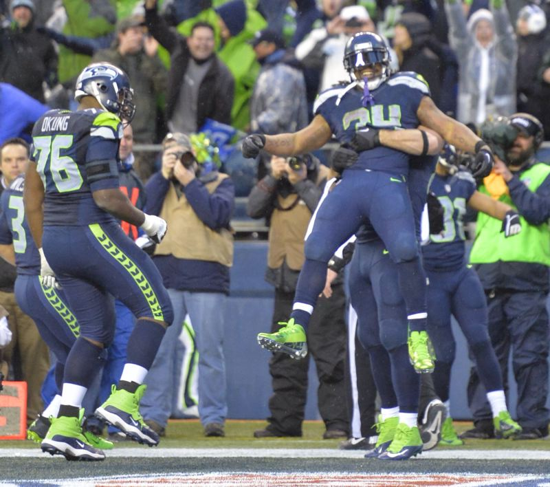 Marshawn Lynch gets to enjoy his second rushing touchdown with teammates in the end zone Saturday, as the Seattle Seahawks advance in the NFL playoffs with a 23-15 win over the New Orleans Saints.