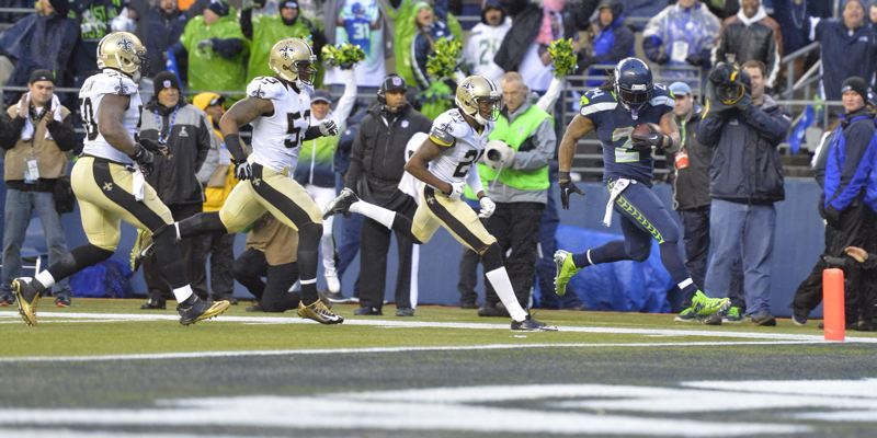 Marshawn Lynch of Seattle beats the New Orleans Saints to the end zone for a key fourth-quarter touchdown Saturday at CenturyLink Field.