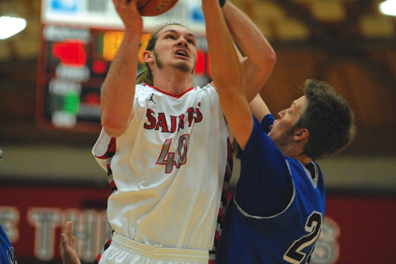 by: THE OUTLOOK: DAVID BALL - Mt. Hood CC center Mac Johnson fights his way to the basket for two of his game-high 24 points Saturday.