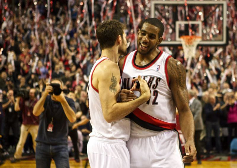 by: TRIBUNE FILE PHOTO: JAIME VALDEZ - LaMarcus Aldridge celebrates a win over Indiana with Trail Blazers teammate Joel Freeland.