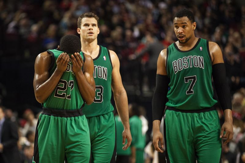 The Celtics (from left) -- Jordan Crawford, Kris Humphries and Jared Sullinger -- react as the game slips away.