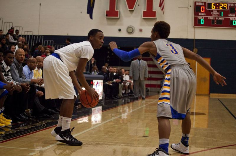by: TRIBUNE PHOTO: ADAM WICKHAM - Grant's Darren Kennedy (left) tries to find a way past Jefferson guard Kadeem Strickland.