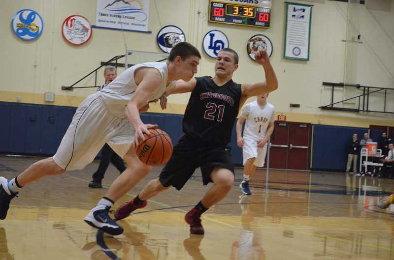 by: JEFF GOODMAN / PAMPLIN MEDIA GROUP - Jace Cates scored 26 points to lead the Canby boys basketball team in a win over Milwaukie at home Jan. 7. The junior also had a team high with 15 points in the Cougars' victory at Grant three days later.