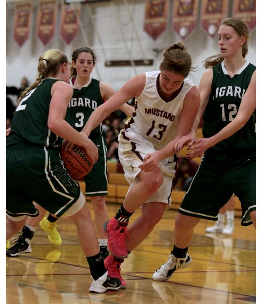 by: JON HOUSE - Milwaukie sophomore Julia Rivers is stripped of the ball by junior guard Kaylie Boschma in last weeks 56-22 loss to Tigard. The Mustangs hope to rebound this Friday, when they host cross-town rival Putnam in a Northwest Oregon Conference league game.