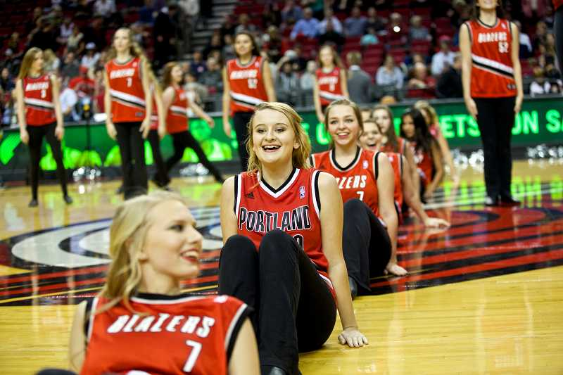 by: JAIME VALDEZ / PAMPLIN MEDIA GROUP - Members of the Canby dance team form a line at halfcourt. From front, Leona Gwynn, Brielle Winklebleck and Katie Dalling.