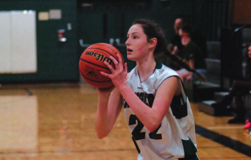by: ESTACADA NEWS: PARKER LEE - Estacadas Josie Beguelin puts up a shot from the sideline during the teams 73-47 win over Taft on Friday.