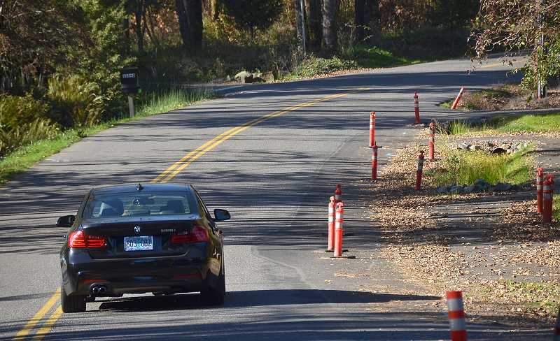 by: REVIEW FILE PHOTO - A car travels on Goodall Road, which has been widened multiple times over the years as vacant properties were developed. An election for voters to weigh in on recently approved road expansions here has been canceled.