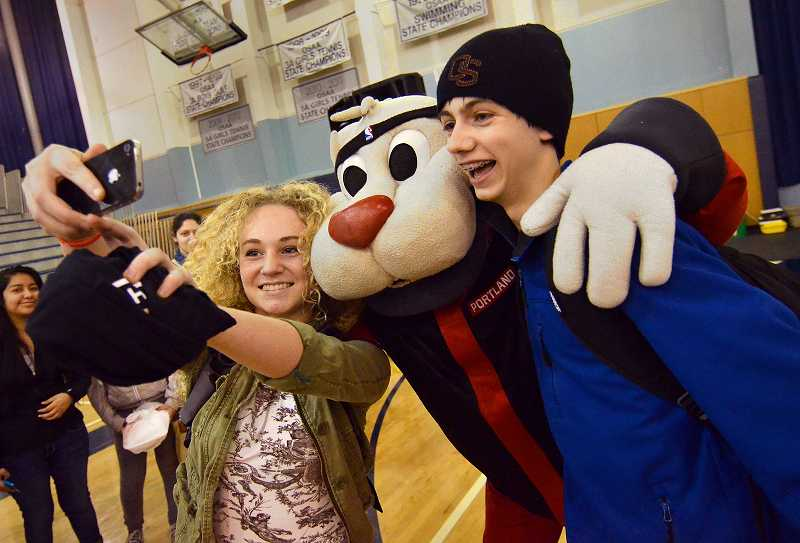 by: PAMPLIN MEDIA GROUP: VERN UYETAKE - Wilsonville freshmen Anna Carr and Steve Prescott take a picture with the Trail Blazer mascot.