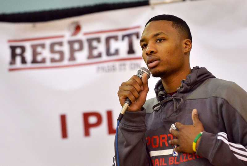 by: PAMPLIN MEDIA GROUP: VERN UYETAKE - Damian Lillard addresses the WHS student body at an assembly Jan. 10.