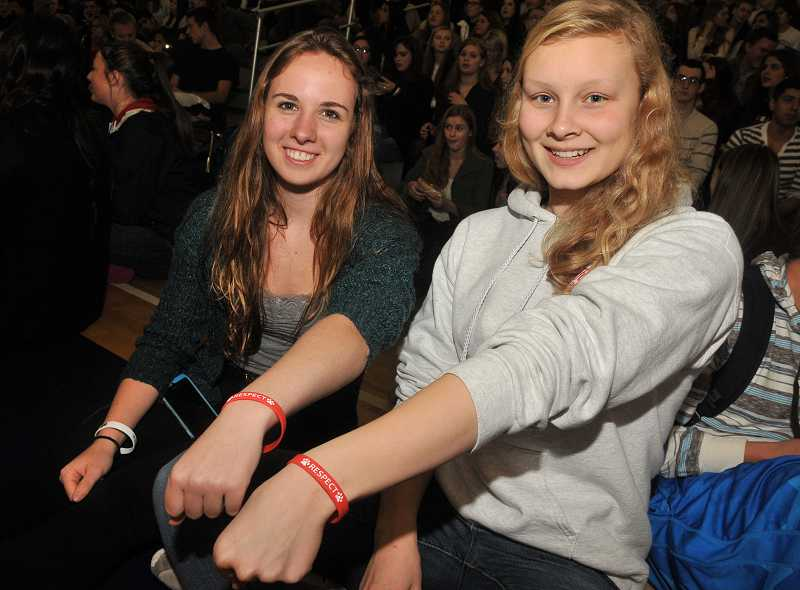 by: PAMPLIN MEDIA GROUP: VERN UYETAKE - Kierra Rowan, left, and Christie Halverson show off the wristbands distributed to each student at WHS.