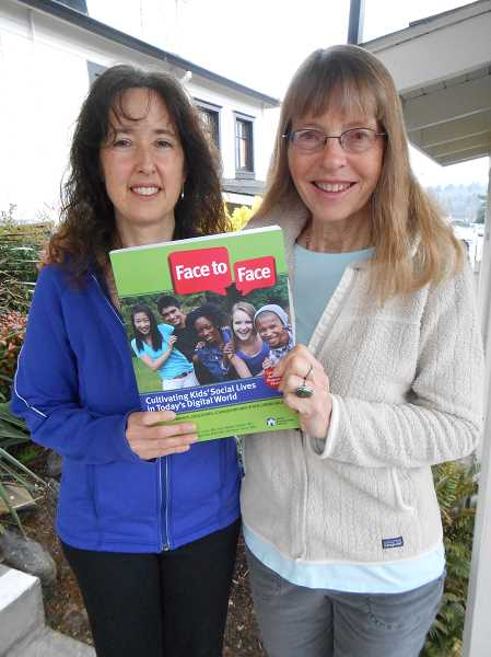 by: CLIFF NEWELL - Monique Terner, left, and Kathy Keller Jones have contributed to the new book Face to Face, a how-to manual for parents worried about too much technology in their children's lives.