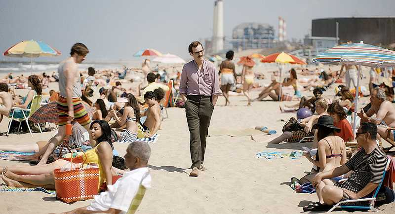 by: SUBMITTED PHOTO - New love -- Theodore Twombly (Joaquin Phoenix) takes a stroll down a Los Angeles beach with Samantha, his operating system girlfriend, in 'Her, which opened Jan. 10