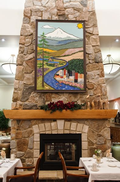 by: SPOKESMAN PHOTO: JOSH KULLA - The finished painting measures 6 by 4 feet and hangs above the fireplace in the dining room at Springridge Court in Charbonneau.