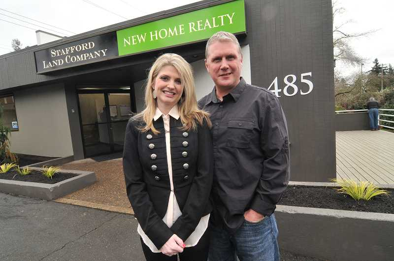 by: REVIEW, TIDINGS PHOTO: VERN UYETAKE - Airika and Rick Waible have opened New Home Realty and Stafford Land Company in Lake Oswego. Not pictured is Gordon Root, who is a partner in Stafford Land Company.