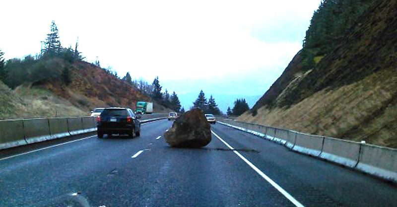 by: CONTRIBUTED PHOTO: OREGON STATE POLICE - Large boulder falls from embankment into easbound lane west of Hood River on Interstate 84.