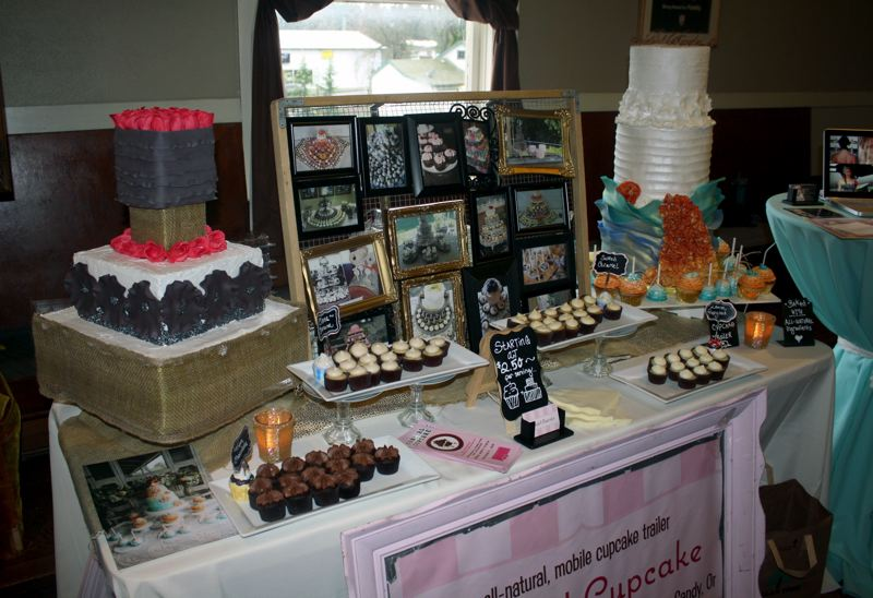 by: POST PHOTO: KYLIE WRAY - Cowgirl Cupcake was one of two cake decorating booths handing out samples of cakes.