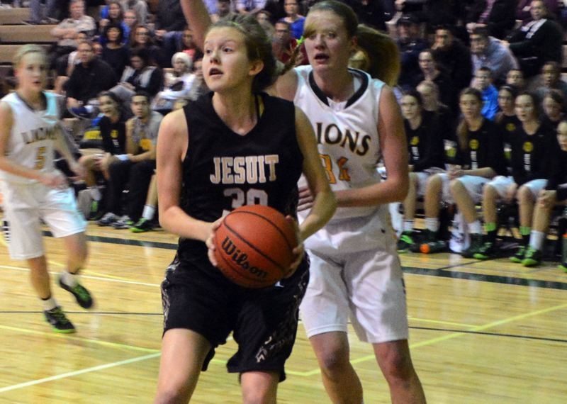 by: TIMES PHOTO: MATT SINGLEDECKER - Jesuit sophomore guard Ellie Sears drives baseline in the first quarter of the Crusaders loss to West Linn.