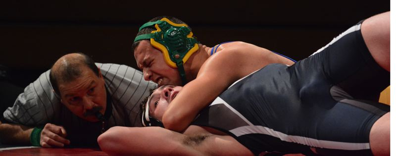 by: TIMES PHOTO: MATT SINGLEDECKER - Aloha senior 220-pound wrestler Concepcion Rodelo went the full six minutes for a win over Westview.